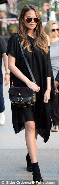 Treat yourself to Chrissy's studded saddle bag by Chloé #DailyMail  Click 'Visit' to buy now