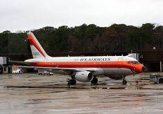 """GRINNING BIRD. Famous for its iconic """"Catch My Smile"""" nose, US Airways honors Pacific Southwest Airlines' legacy with this special retro livery. The Airbus A319 was spotted on the ramp at ORF bound for Charlotte and Atlanta."""