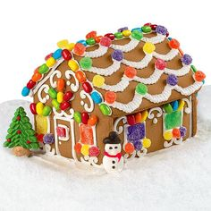 Candy Cottage Gingerbread House - This pre-baked, pre-assembled house is ready for busy little hands to decorate it. Everything is included to make this an enchanted cottage. Gum drops, green leaves and mini jelly rounds add to this fantasy get away.