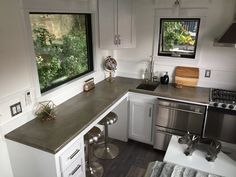 """Aradia"" Tiny House on Wheels by B&B Micro Manufacturing Tiny House Movement // Tiny Living // Tiny House Dining Table // Tiny Home Kitchen // Tiny House Luxury, Modern Tiny House, Tiny House Builders, Building A Tiny House, Elderly Home, Tiny House Movement, Tiny Spaces, Tiny House On Wheels, Large Windows"