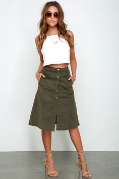 There's no doubt in our minds that the Fairly Certain Olive Corduroy Midi Skirt is going to revolutionize your closet! Deep olive green corduroy falls from a high, banded waist into a midi-length A-line skirt with side-seam pockets. A brass snap-button placket decorates the front, leaving the bottom of the skirt with slit-like detail. Unlined. 97% Polyester, 3% Spandex. Hand Wash Cold. Imported.