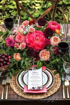 Each flower stands out in this stunning centrepiece, accented by cherries! Love!