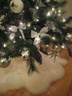 2 faux sheepskin rugs from Ikea make a fluffy Christmas tree skirt ... looks like snow
