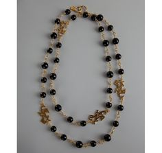 Chanel gold and black beaded Chanel charm vintage long necklace | BLUEFLY up to 70% off designer brands