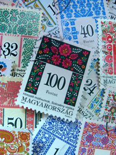 A listing for 16 used Hungarian postage stamps featuring gorgeous traditional folk patterns! no duplications; 16 different stamps  Numbers represented: 1,2,3,5,9,11,12,14,17,19,22,24,32,40,50,100 all in Forints which is the Hungarian currency  These stamps date from 1992 through to the late 1990s  Size: approx 1 x 1 1/4 Colors: multiple  Collectable...or...paper craft?...your choice. Scrapbooking, cards, ATC/ACEO and collage  This is a standard photo. You will receive the similar stamps as…
