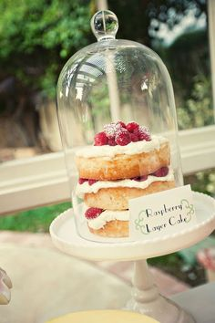 adore exposed sides with fruit layers.  and  love cake plate with bell jar cover.