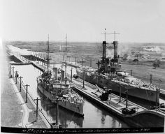 The Cruiser USS OLYMPIA and Battleship USS FLORIDA side-by-side in the Panama Canal, 1922.