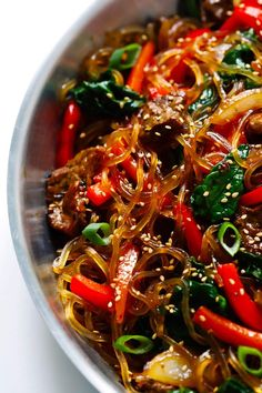 Japchae this easy Korean noodle stir-fry recipe is quick and easy to make it s full of veggies red peppers carrots onions mushrooms spinach and tossed in the most delicious sesame-soy-maple sauce Asian Recipes, Healthy Recipes, Ethnic Recipes, Easy Korean Recipes, Healthy Food, Spinach Recipes, Delicious Recipes, Stir Fry Recipes, Cooking Recipes