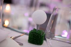 Golf place card holder but use a piece of wood instead of grass