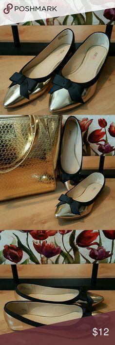NWOT Goldtone Black Ribbon Pointed Toe Flats New without tags (NWOT). Goldtone Metallic Look and Black Ribbon Bow Pointed Toe Flats by Just FAB. Tried them on too wide for my feet, other than that never worn. No box. JustFab Shoes Flats & Loafers