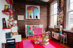 Bright and bold with exposed brick! Gorgeous!