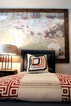 Framed map, Greek key spread, drum lampshade. A lot of nice things going on in this bedroom.