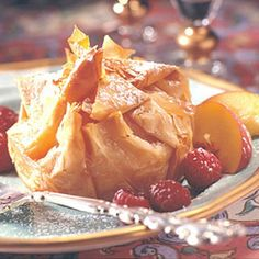 Phyllo dough, low in calories and fat, creates a delicate shell for a peach and chocolate filling in this amazing dessert recipe.