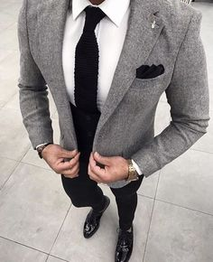 For a smart casual outfit, go for a grey wool blazer and black chinos — these items go brilliantly together. Channel your inner Ryan Gosling and go for a pair of black leather oxford shoes to class up your getup. Black Chinos, Black Trousers, Grey Blazer Black Pants, Grey Blazer Mens, Grey Blazer Outfit, Brown Pants, Chinos And Blazer Men, Grey Suit White Shirt, Black Jeans