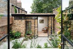 The Greenwich Garden Studio is partly built from bricks reclaimed from the old washhouse and garden walls and the openings which are glazed . Outdoor Office, Backyard Office, Backyard Studio, Garden Office, Brick Shed, Brick Garden, Garden Walls, Garden Cabins, Garden Houses