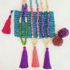 Purple passion. www.brightnewpenny.com.   Tassel necklaces, wooden bead necklaces , clutch purse - Color crush purple and turquoise. https://www.etsy.com/shop/Brightnewpenny