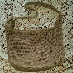 DONATING 7/31....Saks Tote CLOSET CLOSING... LAST CHANCE   Beautiful brown color tote! Lightly used, pocket on back and inside, inside of bag is very clean!  About 11 1/2 high by 12 in across Sak Bags Totes