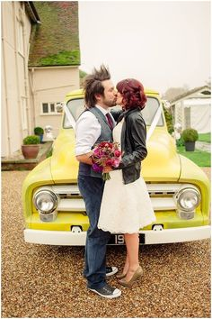 Rock n roll wedding. Short lace wedding dress by True Bride, converse wedding shoes, Bride in leather jacket, contrast gold retro wedding shoes, pheasant feather bouquet. Autumn/winter wedding. Bride and Groom alternative/unique wedding inspiration. Photography by Kerrie Mitchell.
