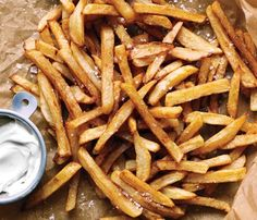 Gwenyth Paltrows No-Fry Fries: 2 lrg russet potatoes; 2 tbsp olive oil; coarse sea salt. Heat oven to 450. Cut potatoes in half horizontally; cut each half into 1/3-inch-thick fries and place in a bowl of cold water. Remove from water and dry thoroughly. Toss with oil and sprinkle with salt. Place fries on a cookie sheet. Roast until browned and cooked through, turning occasionally, 25 minutes.