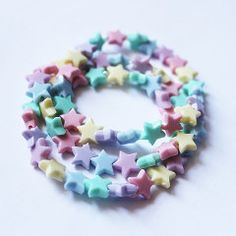 A pack of 3 pastel rainbow colored star bracelets. These adorable bracelets are perfect for the summer with its soft colors. You will receive 3 stretch bracelet
