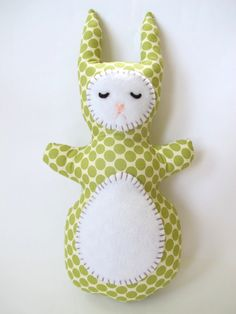 This funny bunny loves lazing around catching her zzzzzzs.....She would be the perfect addition to a nursery - in the crib, on a shelf, or as a little pillow on a chair. I made her with Full Moon Polka Dot fabric in Lime from Amy Butlers Lotus collection. The fabric features lime green polka dots on a cream background. Her face and tummy are made of soft white fleece and are hand-stiched with embroidery thread in smoky purple. Her eyes are made of dark brown felt, and her nose is made of…