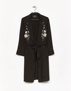 Long dressing gown with floral embroidery and belt. Discover this and many more items in Bershka with new products every week