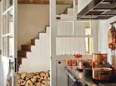 using doors instead of walls, you can either open the space or close the space. love the staircase...