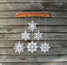 This Christmas holiday decoration is made of cherry tree wood and 6 white…
