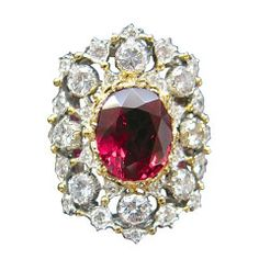 Two color of gold Buccellati ring set with a ruby and diamonds.