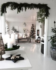 White living room with dark green Christmas accents Fir green as . - White living room with dark green Christmas accents Fir green as a garland over the passage – -