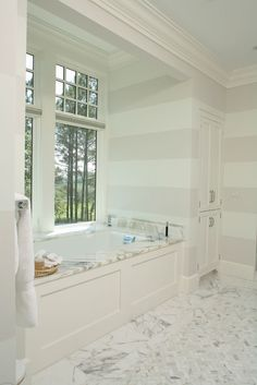 I am loving the striped wall. Makes me want to change my whole bathroom idea I have
