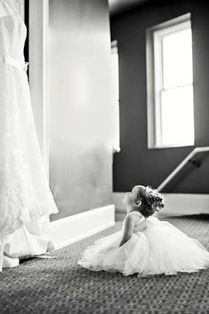 i know I pin a lot of flower girl poses, but theyre just so darn cute! Flower girl looking at wedding dress.