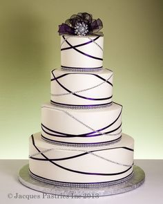 Art deco-inspired ecru colored cake with bling and ribbons