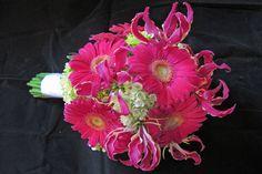 Hot pink gerbera daisies, mini green hydrangeas and gloriosa lilies. #Love the daisies that's it <3