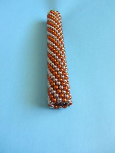 bucky balls, magnetic balls strung together in a twist pattern cylinder