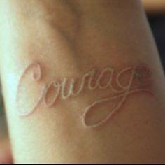 courage..... i loveeee the light tatoos. <33