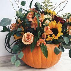 Carve a pumpkin vase to use as a seasonal centerpiece. Carve a pumpkin vase to use as a seasonal centerpiece. Carve a pumpkin vase to use as a seasonal centerpiece. Pumpkin Vase, Pumpkin Flower, Pumpkin Centerpieces, Thanksgiving Centerpieces, Floral Centerpieces, Pumpkin Floral Arrangements, Fall Arrangements, Thanksgiving Flowers, Thanksgiving Table