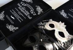An invitation to a black and white masquerade party. His and hers custom-designed, jewel and sequin masks tied to a black velvet pillow. The invitation box featured a black velvet interior and white foil printing. Perfect for Mardi Gras themed wedding inspiration invitation