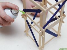 How to Build a Popsicle Stick Tower. Popsicle stick towers are a common engineering project to be assigned in school.Your assignment may have various criteria for height, weight, and number of popsicles, but this guide will give you a. Engineering Projects, Outdoor Learning, Wood Glue, Popsicle Sticks, Diy Wood Projects, Popsicles, Tower, Tableware, Building
