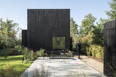 Tiny Holiday Home, a compact black house by and Chris Collaris, stands out like a minimalist sculpture in a nature reserve in Utrecht, Netherlands. Utrecht, Architecture Religieuse, Wood Facade, Design Minimalista, Compact House, Timber House, Polished Concrete, Architect Design, Residential Architecture