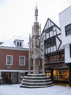 The Butter Cross, Winchester in the snow.  Early 15th Century. Its name originates from the fact that they were located at the market place, where people from neighbouring villages would gather to buy locally produced butter, milk and eggs. The fresh produce was laid out and displayed on the circular stepped bases of the cross. Photograph by Martin Tod, via Flickr