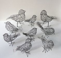 """Nine of 25 wire birds - each unique - commissioned by Christopher Young Studio for Harry Winston (""""Jeweler to the Stars"""") holiday windows around the world."""