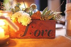 "Love the box and flower arrangement, minus the ""love"" - cute for bathroom, small tables, etc"