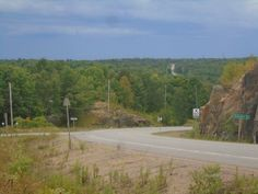 HIGHWAY 518--SEGUIN TOWNSHIP ONTARIO  One of my favourite scenes taken near Haines Lake in Seguin Township near Parry sound is this wonderful distance on Highway 518 looking West.