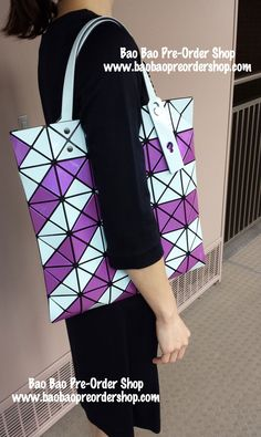 """Lucent Glow"" Tote Bag by Bao Bao Issey Miyake. The bag that really glows in the dark!!  Color: White & Pink Purple  Size: H34xW34(cm) >>To Order, please message/email via the platform below<< ♥️FB Inbox: https://www.facebook.com/messages/baobaohandbags ♥️Email: welovebaobao@gmail.com"