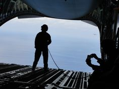 Here's our loadmaster, standing close to the edge and watching the second C-17 following behind us.