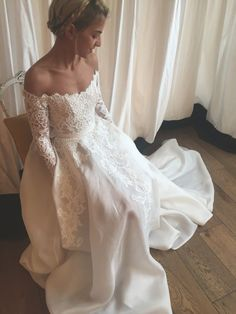 Off the shoulder long sleeve lace wedding dress.