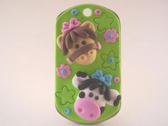 Polymer clay covered dog tag. Adorable!
