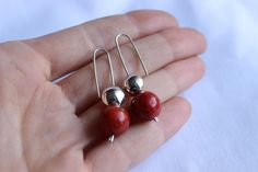 "Contrast earrings made of Sterling silver, copper and Red sponge coral.  What I like most of these earrings is the contrast wich plays the silver with the cooper, the peller moves inside the silver axis permitting to be used both-side.    Dimension: Small balls: 0.35"" diametre (9 millimetters)  Lenght: 1,57"" (40 millimeters)    The perfect match:  https://www.etsy.com/listing/73396184/contrast-pendant-sterling-silver-and    ►All my products are designed and handmade b..."