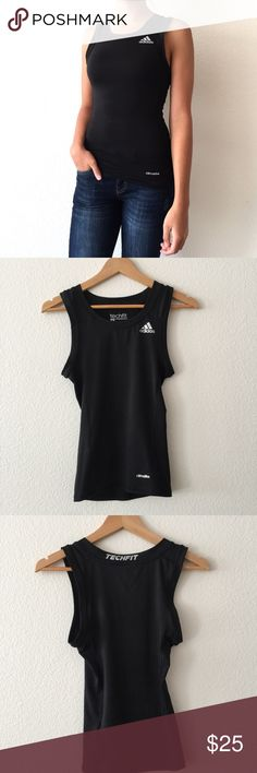Adidas Climalite Compression Black Tank Top Black with silver logos Adidas compression tank top. Quite long, stretchy, and tight fitting. Sides are slightly mesh- very breathable. Adidas Tops Tank Tops